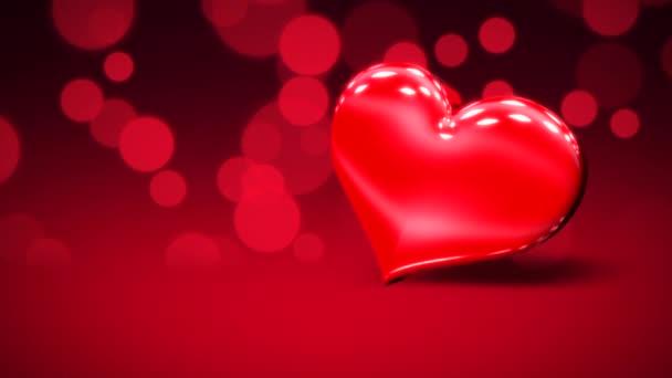 Animáció closeup mozgás nagy romantikus szív és kis szív piros Valentin nap fényes háttér