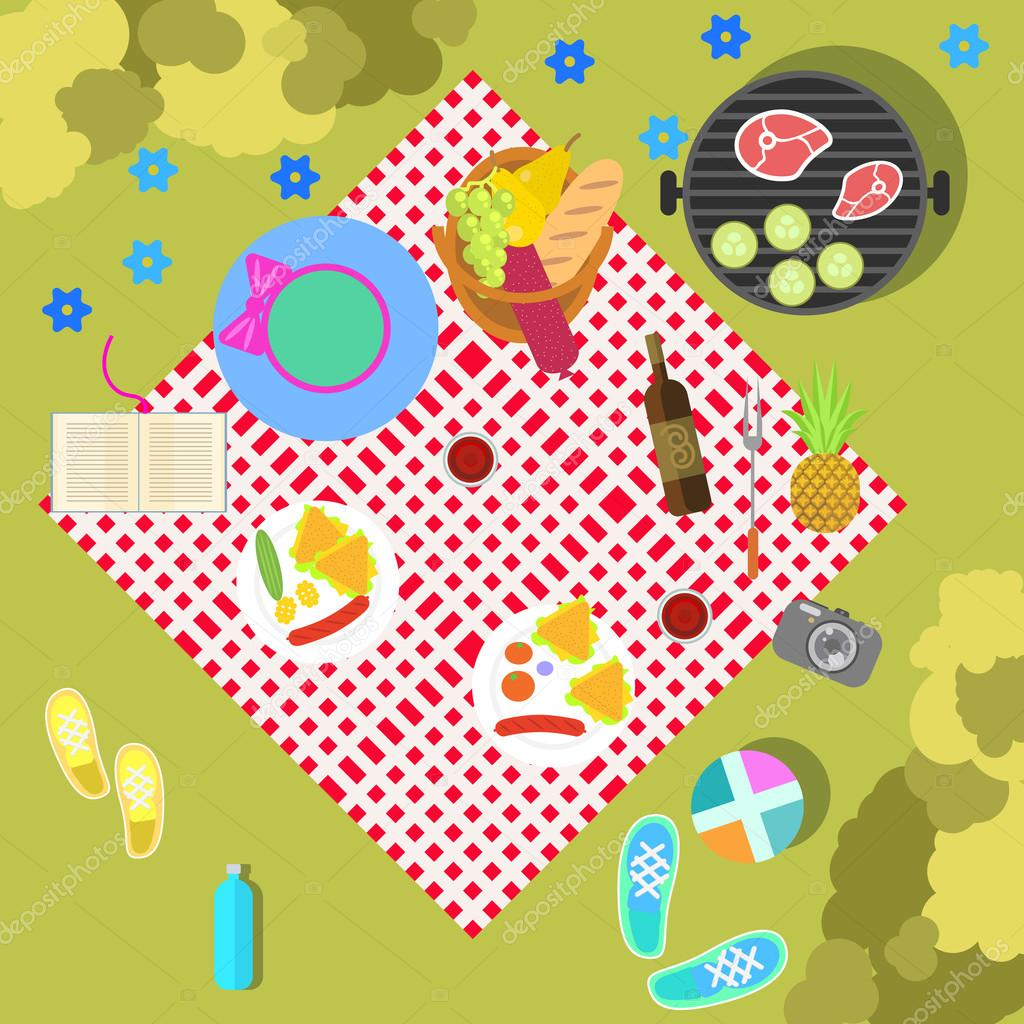 Summer picnic on nature landscape with blanket and basket of food, top view. Family outdoor healthy recreation