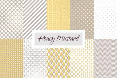 Mustard yellow and taupe geometric seamless pattern set.