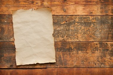 old paper nailed to a wooden door