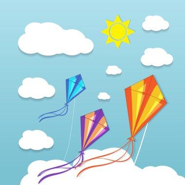 Three kites in the sky