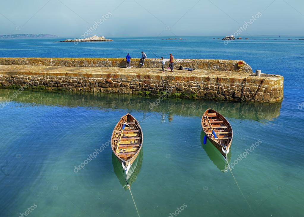 Rowing boats beside harbour