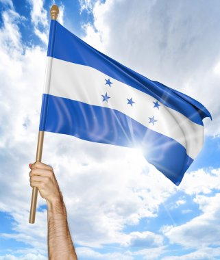 Person's hand holding the Honduran national flag and waving it in the sky, 3D rendering