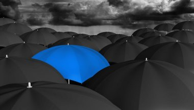 Leadership and innovation concept of a blue umbrella in a crowd of black ones