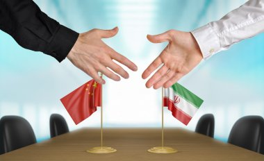 China and Iran diplomats agreeing on a deal