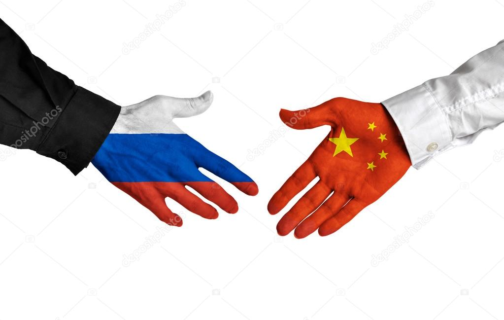 Russian And Chinese Leaders Shaking Hands On A Deal Agreement
