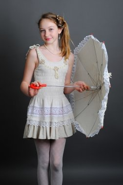 girl in a linen sundress with sun umbrella