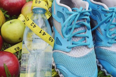 Sneakers, centimeter, red apples, weight loss, running, healthy eating, healthy lifestyle concep