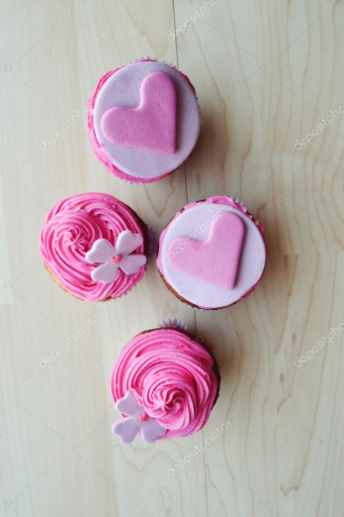 Pink cupcakes, with cream ,decorated with hearts,Valentine's day,international women's day,love.Notepad