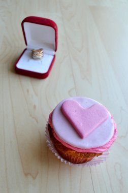 Pink cupcakes, with cream ,decorated with hearts