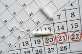 Fotografie Menstruationskalender mit Sanitärtampons