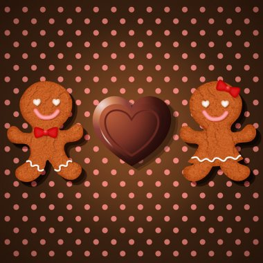 loving couple of gingerbread cookies and heart chocolate