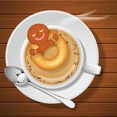 zázvorový chléb s prstenci v šálku horké kávy