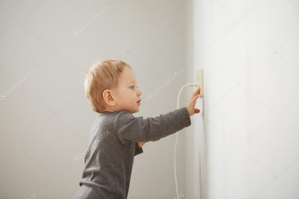 Curious Little Boy Playing With Electric Plug. Trying To Insert It Into The  Electric Socket. Danger At Home U2014 Photo By Avemario