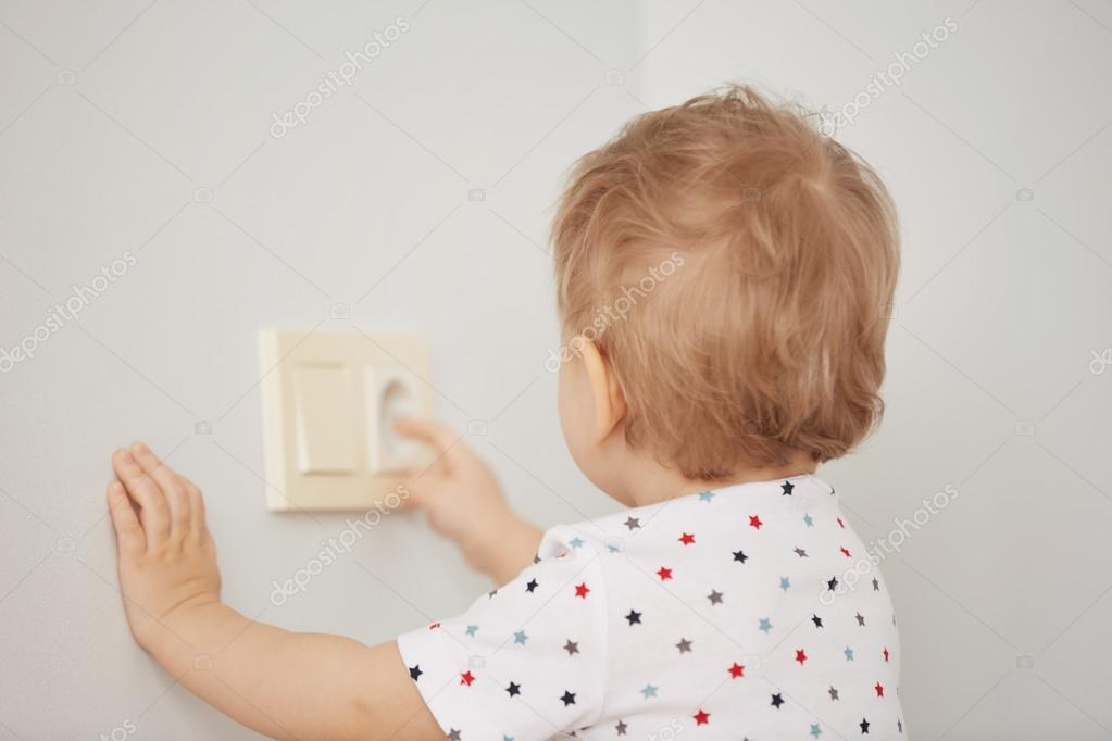 Attractive Curious Little Boy Playing With Electric Plug. Trying To Insert It Into The  Electric Socket. Danger At Home U2014 Photo By Avemario