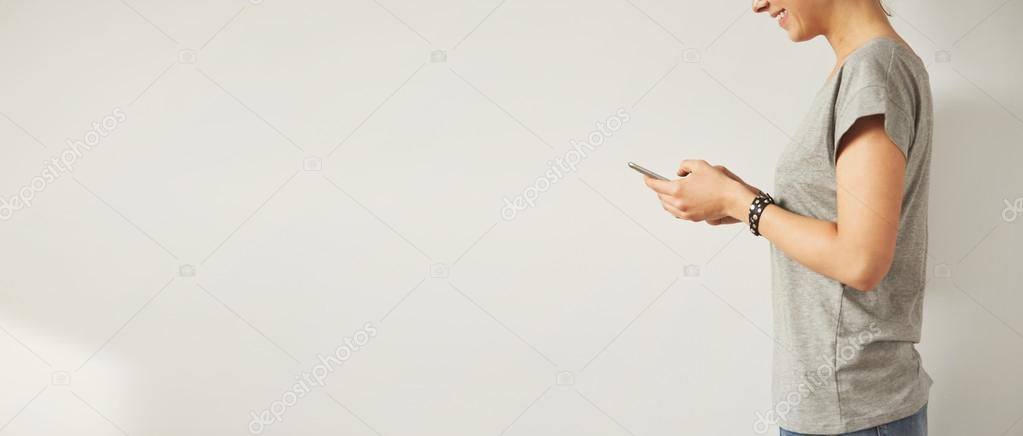 female checking email with cell phone