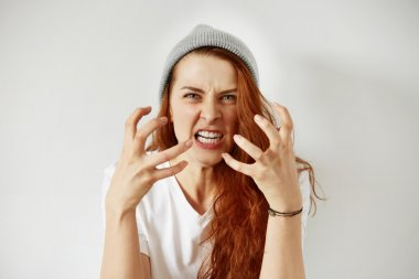 woman holding hands in furious gesture