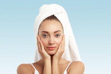 female with bath towel on head
