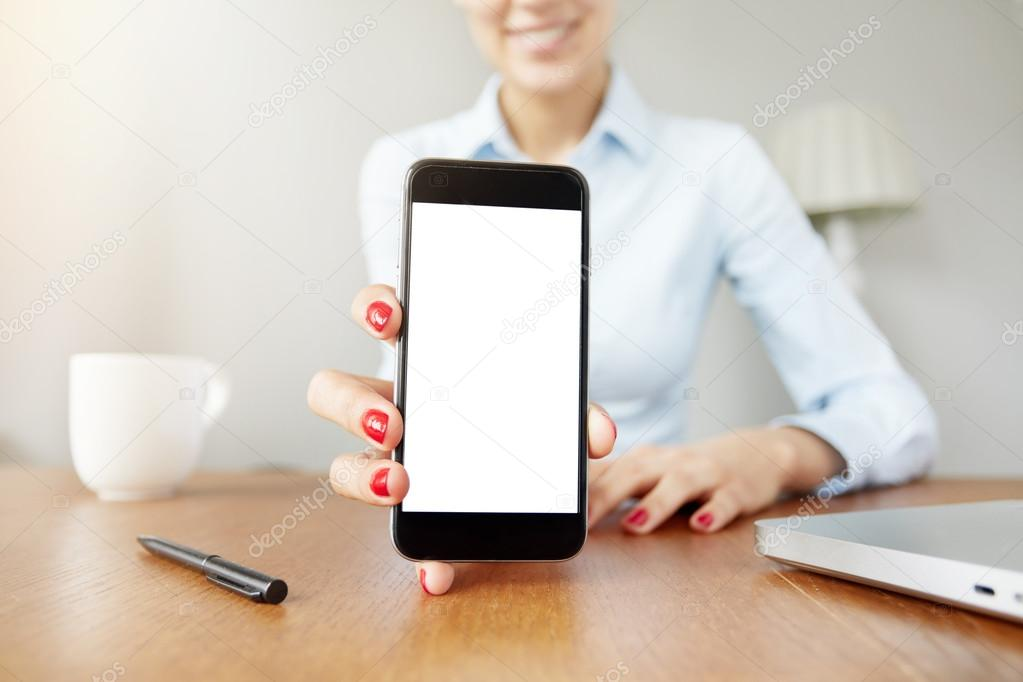 female office worker showing cell phone