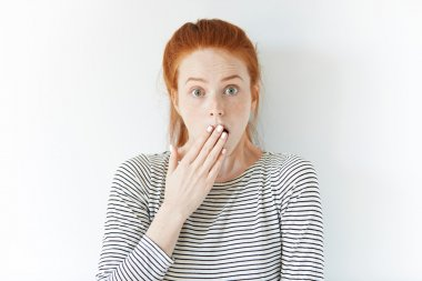 Shocked young redhead woman