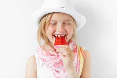 Laughing girl with red popsicle