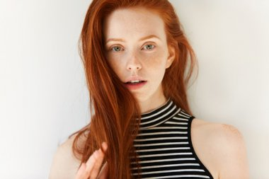 sensual female with long red hair