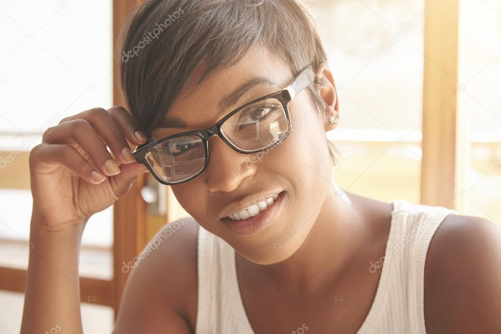 Dark Skinned Woman In Glasses With Short Haircut Stock Photo