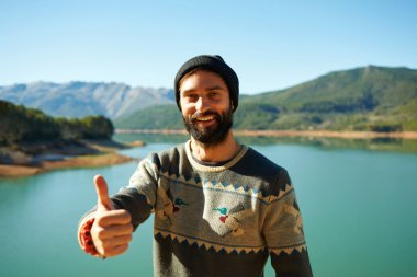 Summer fun man showing thumbs up smiling happy bearded model. Po
