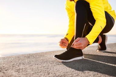 Running shoes being tied by man getting ready for jogging. Close