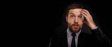 Closeup portrait of handsome bearded businessman looking shocked, surprised in disbelief, with hands on face looking at you camera, isolated on background. Positive human emotions, facial expressions.