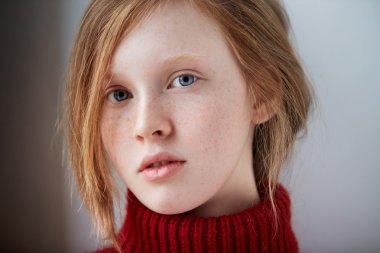 Red haired and freckled young woman