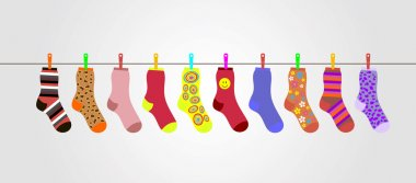 vector colorful socks on gray background are hanging on rope