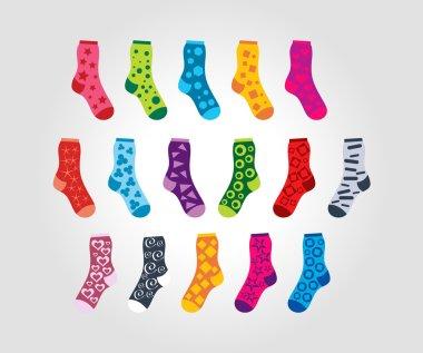 set of of socks with different patterns motives on a light backg