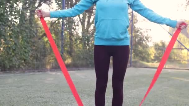 girl goes in for sports with a gymnastic ribbon
