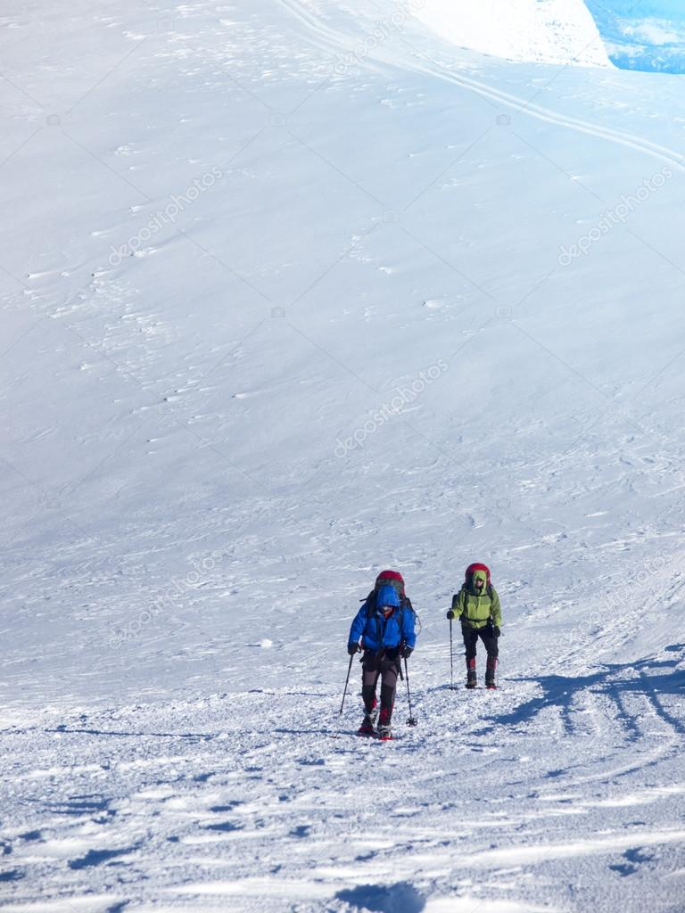 Climbers are on the snow shod in boots.
