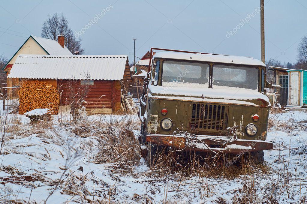Rusty  lorry abandoned in rural field