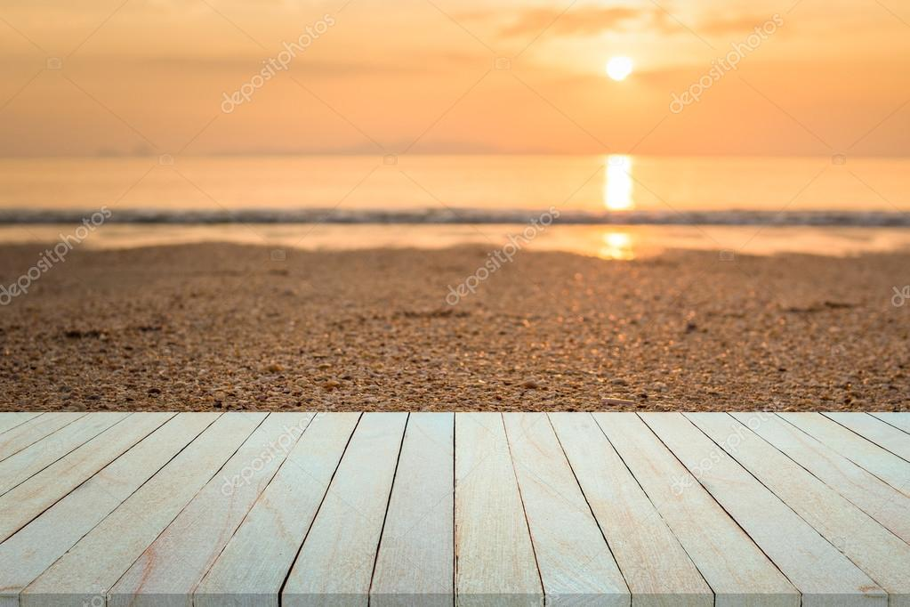 Empty top view of wooden table and view of sunset or sunrise on sand beach background & Empty top view of wooden table and view of sunset or sunrise on sand ...