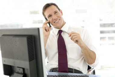 Single young businessman on the phone