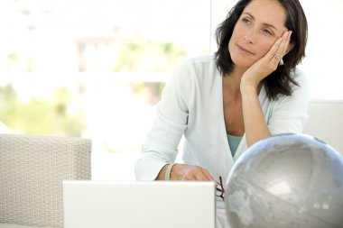 Woman using pc at home