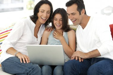 Happy Family with one child using laptop