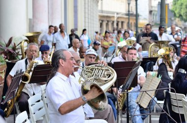 A musician with a french horn in an orchestra  in Havana, Cuba on May 10, 2013.