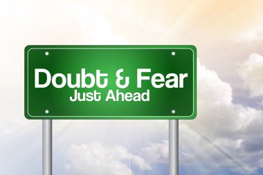 Doubt and Fear Just Ahead Green Road Sign Business Concep