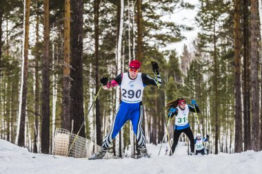 old skiers male athletes up mountain