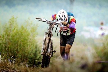 athlete cyclist walking uphill