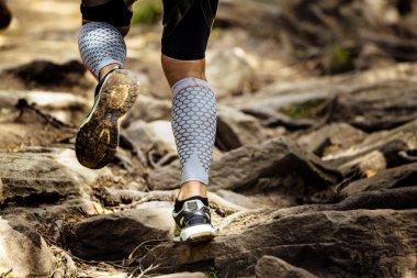 athlete runner runs rocks in mountain
