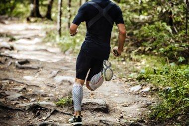 explosive running marathon runner in forest