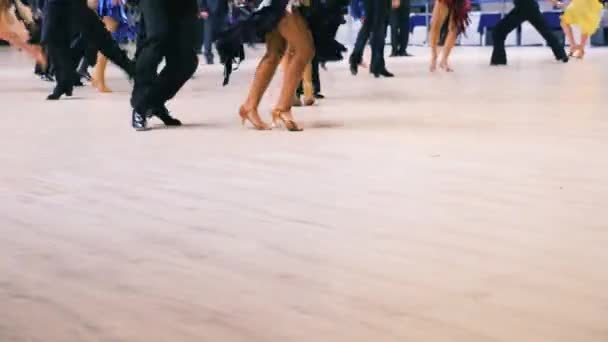 dancing couples of men and women on dance floor