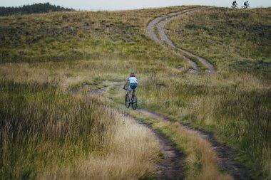 cyclist down the mountain