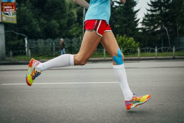 Girl athlete running a marathon