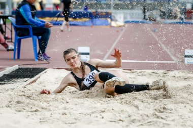 girl athlete long jump